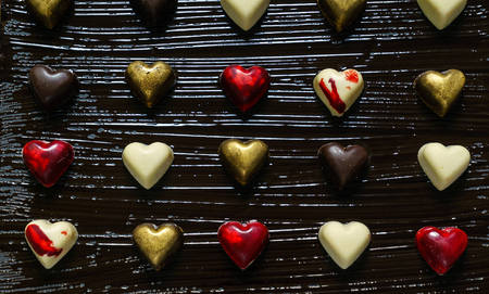 Chocolate hearts on the black Stock Photo