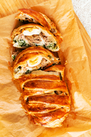 Spinach pie: Italian stromboli with eggs, spinach and mozzarella (Easter pastry) Stock Photo