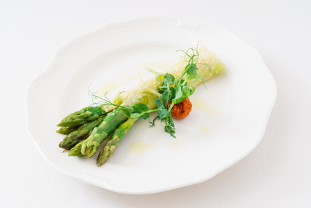 Grilled asparagus on the white plate