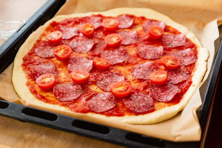 Pepperoni Pizza with Mozzarella cheese, salami, Tomatoes, pepper. Reklamní fotografie - 116268274