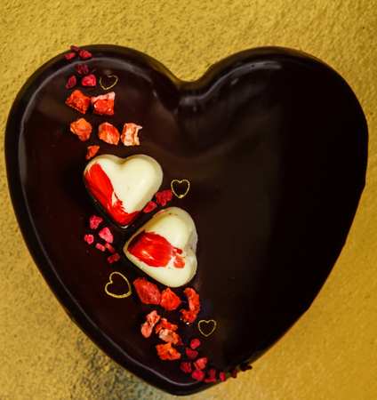 Chocolate hearts on the golden Stock Photo