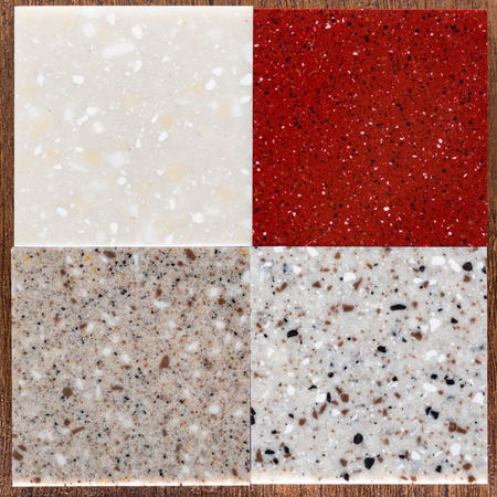 Collection of terrazzo geometric tiles. Bundle of seamless patterns with colorful splinters or sprinkles