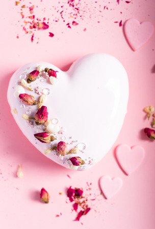 Cake with berries in the shape of heart on Valentines Day