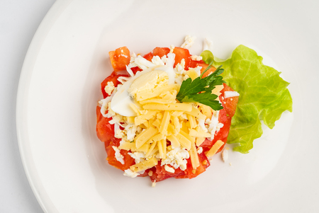 Tomato salad with cheese and mayonnaise