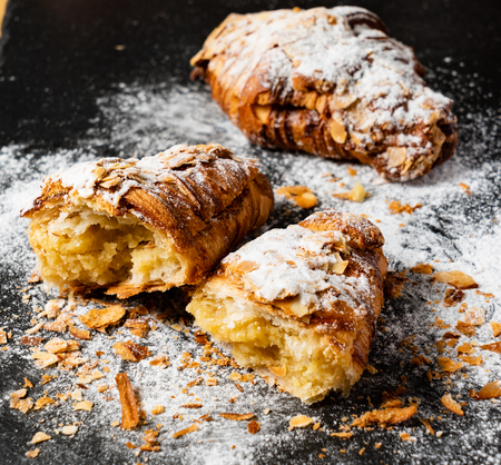 Croissants with almonds on the black