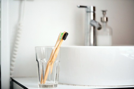 Eco natural bamboo toothbrushes in glass. sustainable lifestyle concept.