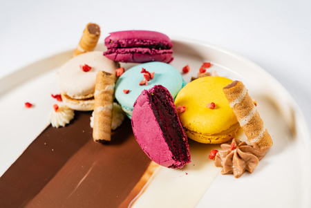 Sweet and colourful dessert with macaroons and chocolate