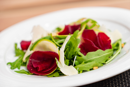 Beetroot carpaccio with arugula leaves