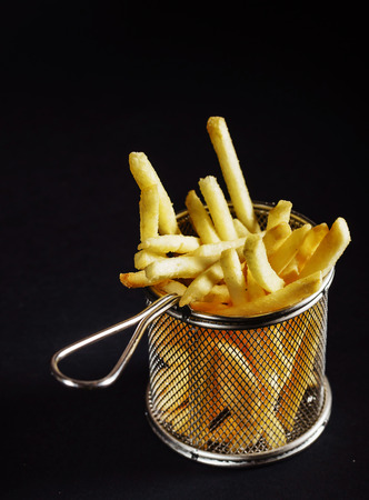 French fries on black
