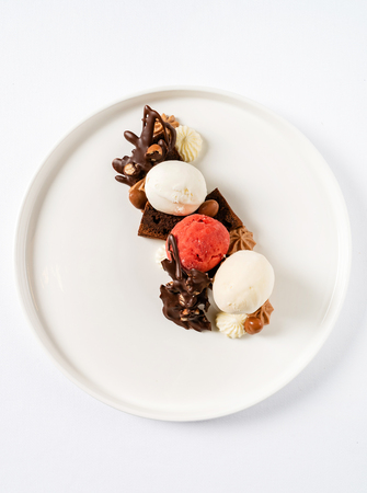 Brownie with ice cream on the white plate Stock Photo