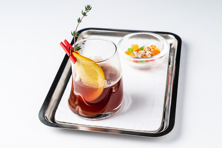 Red tea with candied fruits