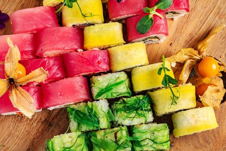 Rainbow Sushi Roll with salmon, eel, tuna, avocado, royal prawn, cream cheese Philadelphia, caviar tobica, chuka. Sushi menu. Stock Photo