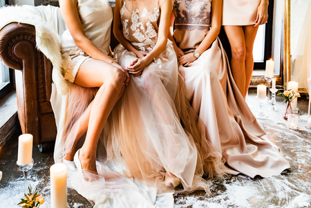 Bride and bridesmaids on the sofa