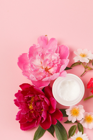 Cosmetic creams with pink flowers Stock Photo