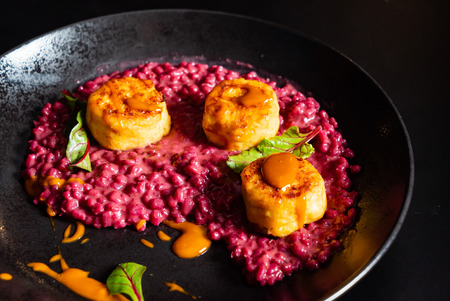 Risotto with beetroot and scallops