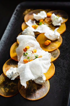 persimmon  carpaccio with  goat cheese and farm cottage cheese 스톡 콘텐츠