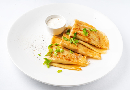 Crepes Suzette with sour cream on the white background Standard-Bild - 117779575