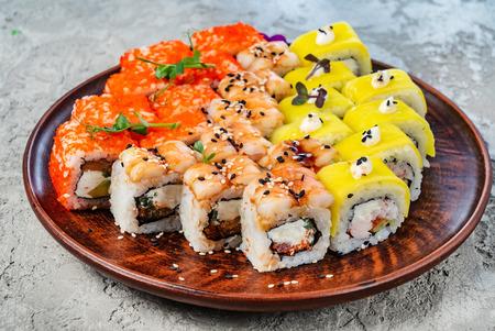 Rainbow Sushi Roll with salmon, eel, tuna, avocado, royal prawn, cream cheese Philadelphia, caviar tobica, chuka. Sushi menu. Japanese food Stock Photo