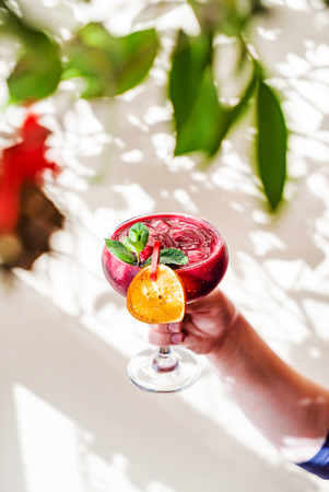 summer mocktail in the hand
