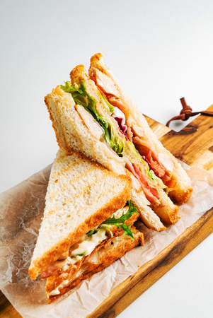 Sandwich with ham, cheese, tomatoes, lettuce, and toasted bread