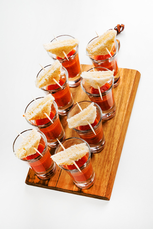 bloody mary cocktails on the wooden board