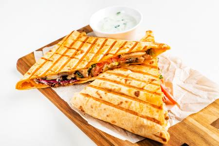 mexican quesadilla with meat, pepper and sauce