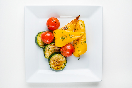 roasted vegetables on the white plate Stock Photo