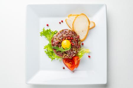 French cuisine, beef steak tartare with raw quail egg yolk