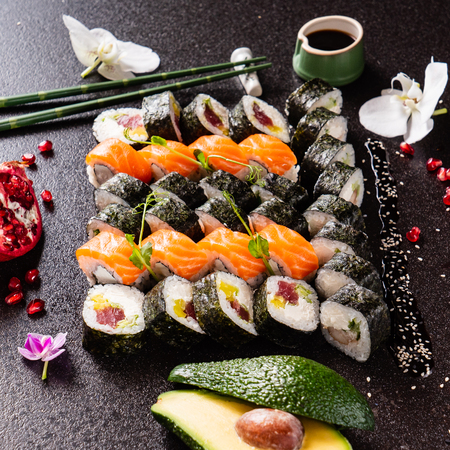 big set of sushi on the black background Stock Photo