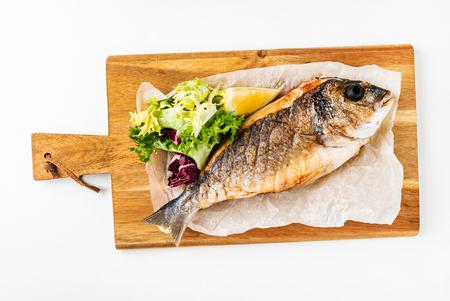 baked fish dorado with salad
