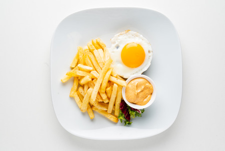 cutlet with egg and french fries Standard-Bild - 118941202