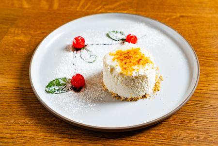 Raw vanilla bean and cherry cheesecake made with paleo ingredients.