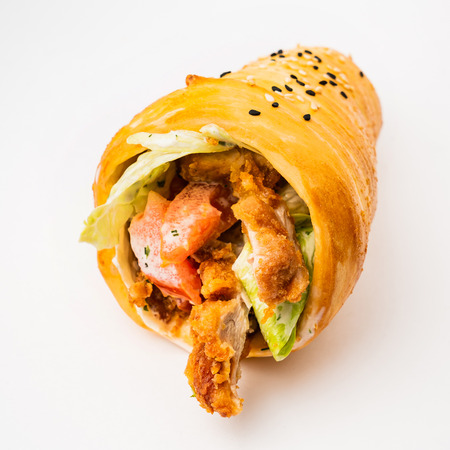 bun wrap with chicken and vegetables on the white background
