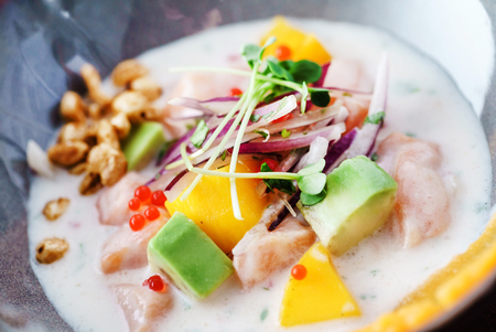 Sevice with salmon and mango Stock Photo