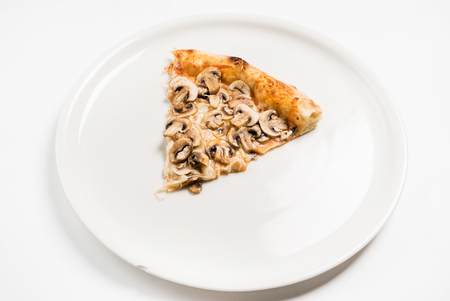 slice of pizza on the white plate Zdjęcie Seryjne