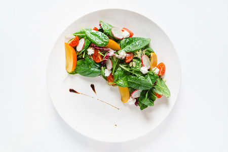salad with spinach and persimmon on the white plate 스톡 콘텐츠