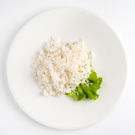 rice on the white plate, top view 스톡 콘텐츠