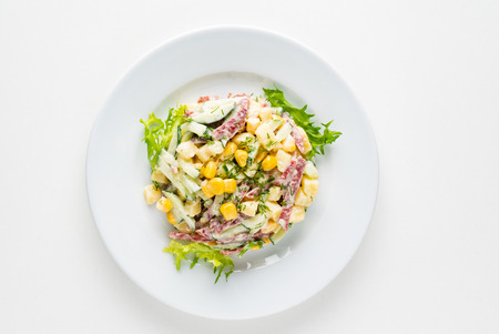 salad with corn on the white plate 版權商用圖片