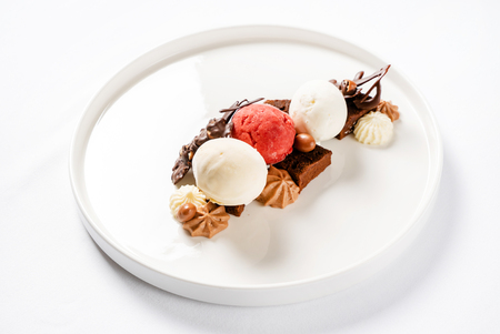 brownie with ice cream on the white plate