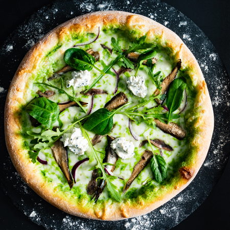 seafood pizza with broccoli, spinach and arugula salad