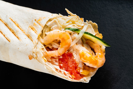 fajita wrap sandwich on the black background