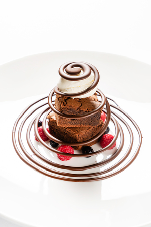 brownie with ice cream and berries