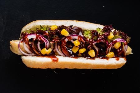 hot dog on the black background Standard-Bild - 119982831