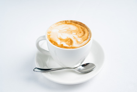 cup of cappuccino on the white background 免版税图像
