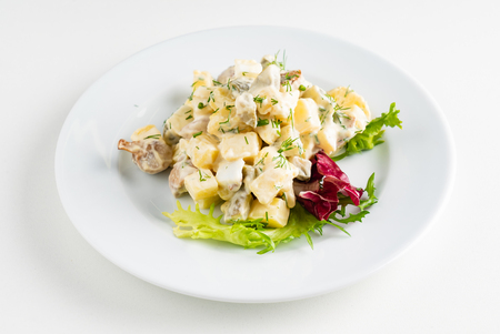 Traditional salad with cooked vegetables with mayonnaise. Standard-Bild - 119982980