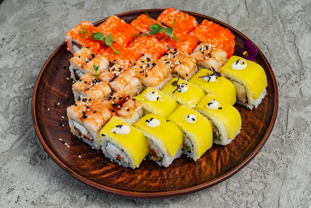 Rainbow Sushi Roll with salmon, eel, tuna, avocado, royal prawn, cream cheese Philadelphia, caviar tobica, chuka. Sushi menu. Japanese food 스톡 콘텐츠
