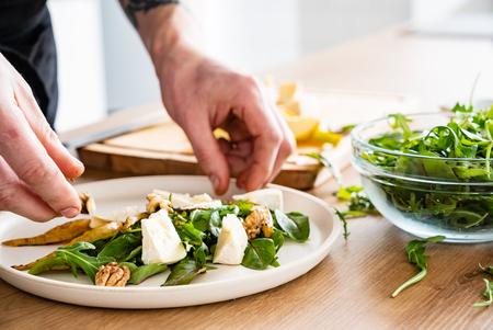 chef making salad on the kitchen Stock Photo