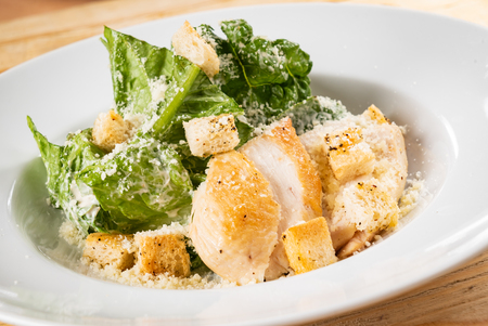 fresh caesar salad in the white plate Imagens