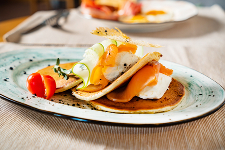 pancakes with salmon and poached egg Foto de archivo - 120734941