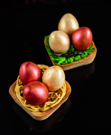 Easter pastry on the black background